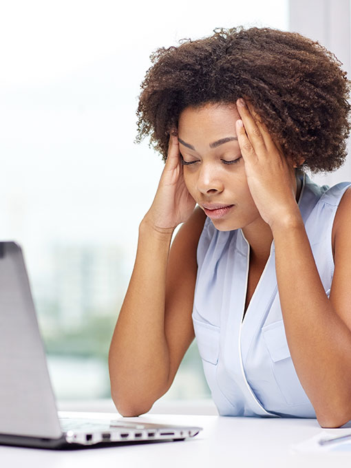 woman at computer trying to file social security disability claim